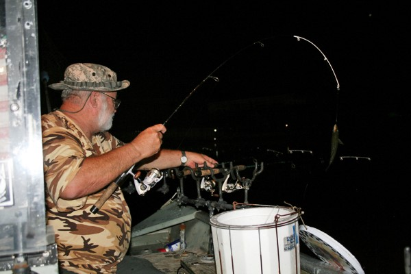 Pulling a fish in at night is as exciting as pulling them in during the day.