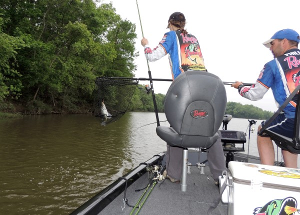 Alicia and Jonathan Phillips pull a crappie from the Alabama River. Knowing and reading current is an important part of river fishing.