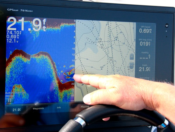 Electronics are primary tools when searching underwater structure. Dannenmueller uses his Garmin unit to look for just the right spot along a ledge.