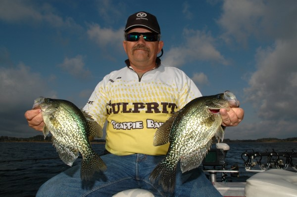 Mike Baker is a professional crappie angler from Silver Springs, Florida. Here he has a couple of crappie caught from Halfmoon Lake near Lynne, Florida.