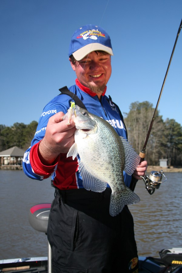 To cut through the frequently muddy waters of Alabama's Coosa River guide Dustin King uses a bright chartreuse head Road Runner with a pearl-white body.