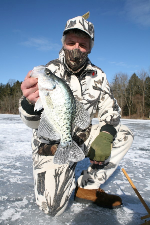 Tip-ups will not catch the numbers of crappie you'll get going from hole to hole with a jigging stick, but by using a bigger bait they catch some pretty large crappie.