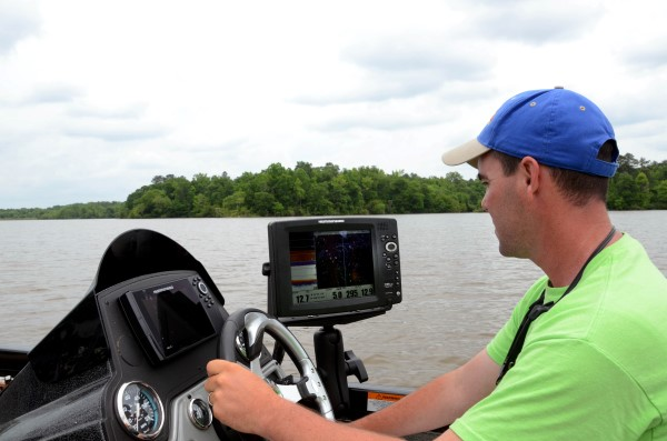 To find the crappie, Phillips uses his Humminbird side-scanning depth finder to locate logjams, sunken trees and natural brush on the edge of the main river channel.