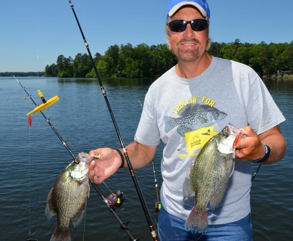 Garrett Steele, from Nashville, Tenn., shows off some crappie he caught while trolling a jig and a crankbait with planer boards on Lake Jordan near Wetumpka, Ala. With planer boards, anglers can spread out their rigs and cover more water by fishing various baits at multiple depths simultaneously.