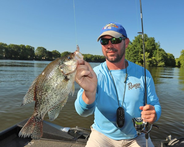 Jonathan Phillips says when crappie are stacked on cover it's a good time to be using a single pole.