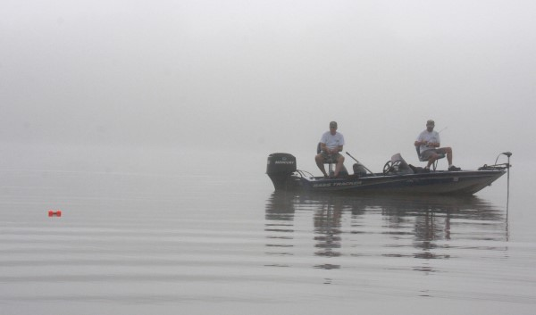 Casting is a good way to work a stump, log or bed. On a foggy morning, these fishermen are casting to cover in a creek marked with a buoy.