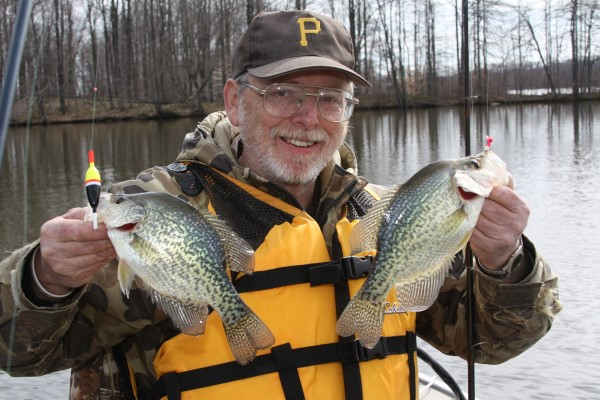 Jim McClave enjoys success on Pymatuning Lake for ice-out crappies holding in a shallow spatterdock pad bed using minnows below a float.