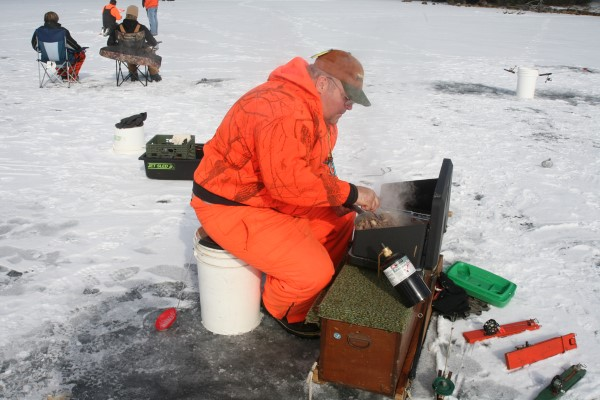 """You can't do this while spider rigging but on the ice you can """"chase"""" crappie with a hot stove and a venison burger."""