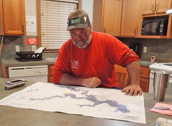 Electronic maps are key for on-the-water searching, but paper maps are still good tools for studying the lake while relaxing in your cabin.