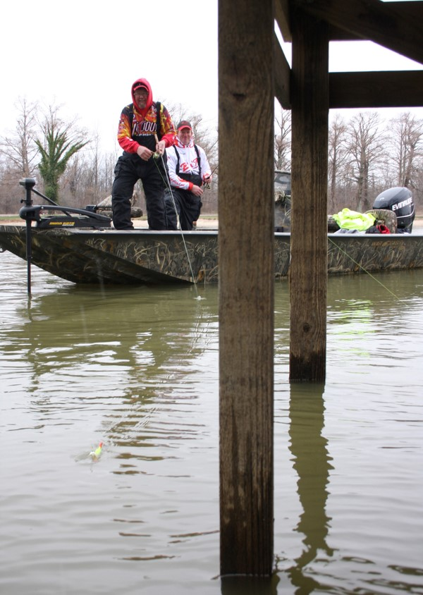 When a lake is pulled down a few feet during the winter, it's easier to get a bait under a piling dock.