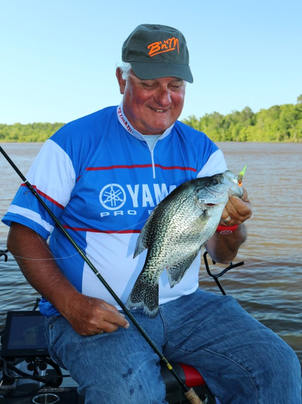 Dannenmueller with a good crappie taken from a submerged brush. Mixing the right area + contour change + cover = crappie.