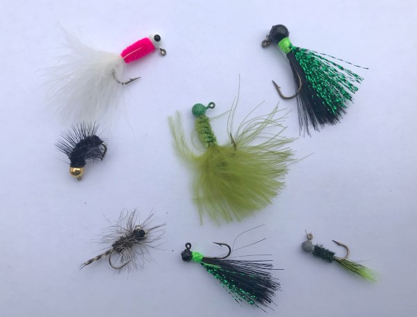 Jigs and flies used to catch crappies during the spring.