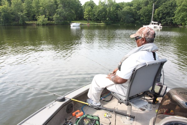 Hang gliding isn't difficult, but boat control is important. Ken Smith is fishing Pymatuning.