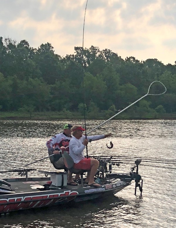 Tim Blackley and Paul Turner catching their fish in an oxbow.