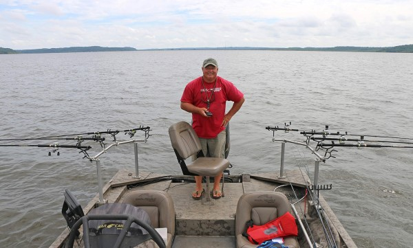 John Harrison pulls cranks out of the back of his boat. A MinnKota Terrova keeps the boat on track and can be controlled by remotely.