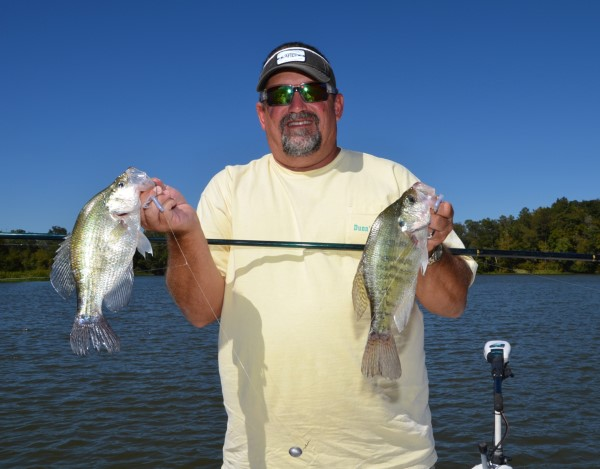 Joe Dunn shows off a couple crappie he caught while fishing on Millers Ferry Reservoir near Millers Ferry, AL.